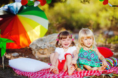 Cute happy children playing in spring filed Stock Image