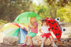 Cute happy children playing in spring filed Royalty Free Stock Photography