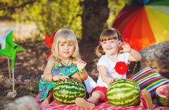 Cute happy children playing in spring filed Stock Photo