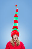 Cute happy Christmas elf with a giant hat Stock Photos