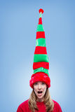 Cute happy Christmas elf with a giant hat Stock Image