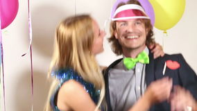 Cute happy couple dancing in photo booth. Cute happy couple dancing in party photo booth stock video