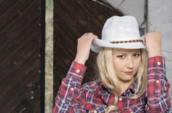 Cute and Happy Cowgirl inside of  Cattleshed Royalty Free Stock Photos