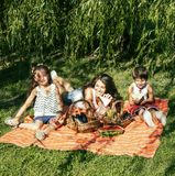 Cute happy family on picnic laying on green grass mother and kid. S, warm summer vacations close up, brother and sister together Stock Images