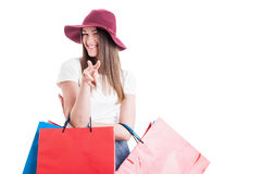 Cute happy female doing a watching you gesture at shopping Stock Images