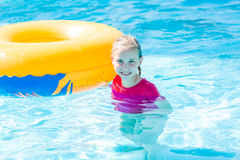 Cute happy girl in amusment aquapark Royalty Free Stock Photo