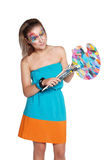 Cute happy girl with colored palette and brushes. On the isolated background Royalty Free Stock Images