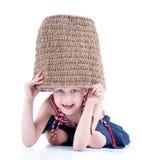Cute happy girl is hide in big basket Stock Photo