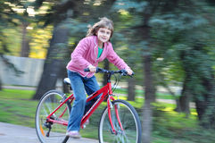 Cute Happy girl riding bike Royalty Free Stock Photos