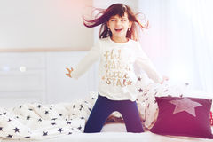 Cute happy girl singing in bedroom in the morning sun light Royalty Free Stock Photo
