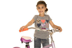 Cute happy girl standing by her new bicycle Stock Photos