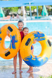 Cute happy girls in amusment aquapark Royalty Free Stock Image