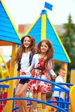 Cute happy girls jumping on toy castle playground Royalty Free Stock Photo