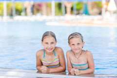 Cute happy girls at the pool Royalty Free Stock Photo