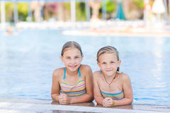 Cute happy girls at the pool Royalty Free Stock Photography