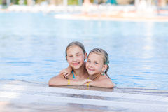 Cute happy girls at the pool Royalty Free Stock Images
