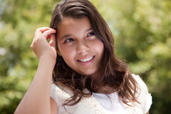 Cute Happy Hispanic Girl in the Park royalty free stock image