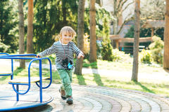 Cute happy kid. Boy playing on playground in a park. stock photos