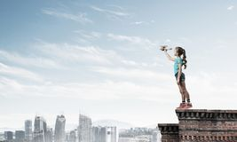 Concept of careless happy childhood with girl dreaming to become pilot stock photography
