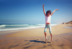 Cute happy kid (girl) playing at the beach Royalty Free Stock Photo