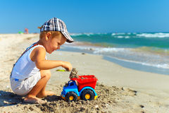 Cute happy kid playing with toy on beach Royalty Free Stock Photography