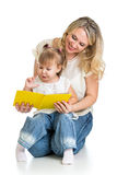 Cute happy kid reading a book. Over white background Stock Photo