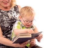 Cute happy kid reading a book. Cute happy kid potter style, reading a book Stock Photography