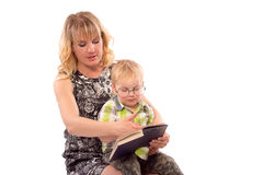 Cute happy kid reading a book. Cute happy kid potter style, reading a book Royalty Free Stock Photo