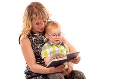 Cute happy kid reading a book. Cute happy kid potter style, reading a book Royalty Free Stock Photography