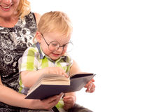 Cute happy kid reading a book. Cute happy kid potter style, reading a book Stock Image