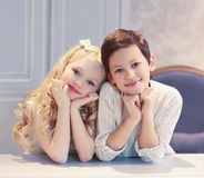 Cute happy kids boy and girl. In the room Royalty Free Stock Images