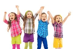 Cute happy kids are jumping together Stock Photo
