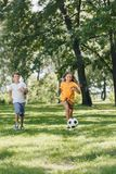 cute happy kids playing with soccer ball stock image
