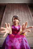Cute and happy little Asian girl smiling at camera Stock Photo