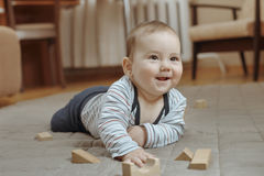 Cute happy little baby boy playing at home Stock Image