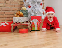 Cute happy little baby boy in Santa suit and old vintage sled wi Stock Image