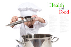 Cute happy little baby cooking Royalty Free Stock Photography