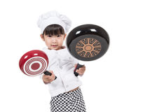 Cute happy little baby cooking. Something Royalty Free Stock Photography