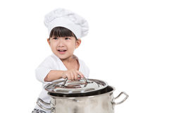 Cute happy little baby cooking. Something Stock Photo