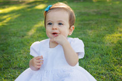 Cute happy little baby girl scratching first teeth Royalty Free Stock Image