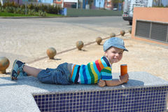 Cute happy little boy with drink Stock Photos