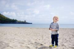 Cute happy little boy enjoy vacation on beach near Tyrrhenian sea royalty free stock photos