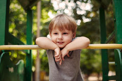 Cute happy little boy leaning on a railing Royalty Free Stock Photo
