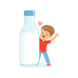 Cute happy little boy standing next to a giant milk bottle, healthy childrens food cartoon character vector Illustration. On a white background Royalty Free Stock Image