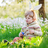 Cute happy little boy wearing Easter bunny ears at spring green Royalty Free Stock Photos