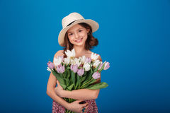 Cute happy little girl with bouquet of flowers Stock Image