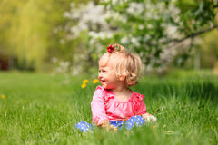 Cute happy little girl with flowers in spring Stock Photography