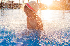 Cute happy little girl having fun in swimming pool Stock Images