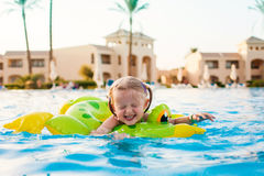 Cute happy little girl having fun in swimming pool Royalty Free Stock Photo