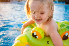 Cute happy little girl having fun in swimming pool Royalty Free Stock Photography
